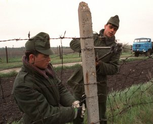 Hungarian soldiers cut through the border fence on 2 May 1989