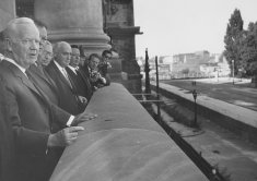 West German President Heinrich Lübke and the Ruling Mayor of Berlin, Willi Brandt, look down from the Reichstag at the barriers on the sector border, 30 August 1961