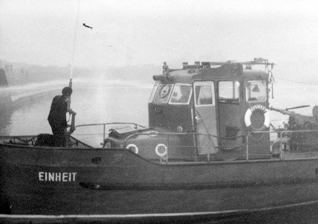 Klaus Schröter, shot and drowned in the Berlin border waters: MfS crime site photo of East German fire department boat on the Spree near the Reichstag building concealing the retrieval of the body [Nov. 4, 1963]