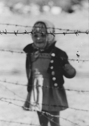 East Berlin child behind barbed wire – Berlin, September 1961