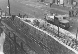 Tear gas used on West Berliners watching workers building the Wall higher, 17 September 1961