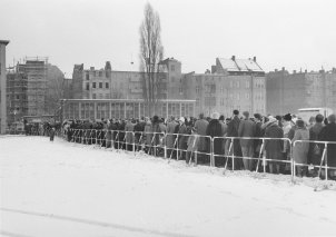 Queues of people waiting for border passes in front of a West Berlin school, December 1963