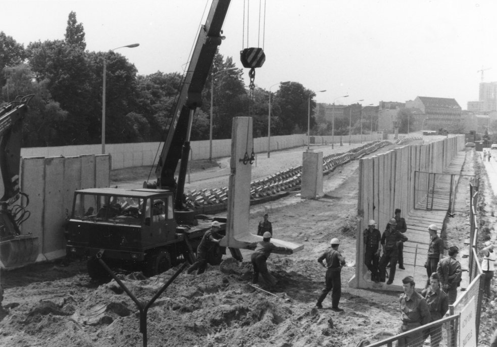 Construction of a new wall with pre-fabricated elements on Bernauer Strasse (taken 7 July 1980)