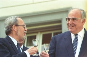 GDR Prime Minister Lothar de Maizière and West German Chancellor Helmut Kohl drink to the signing of the treaty on the economic, currency and social union between the FRG and the GDR