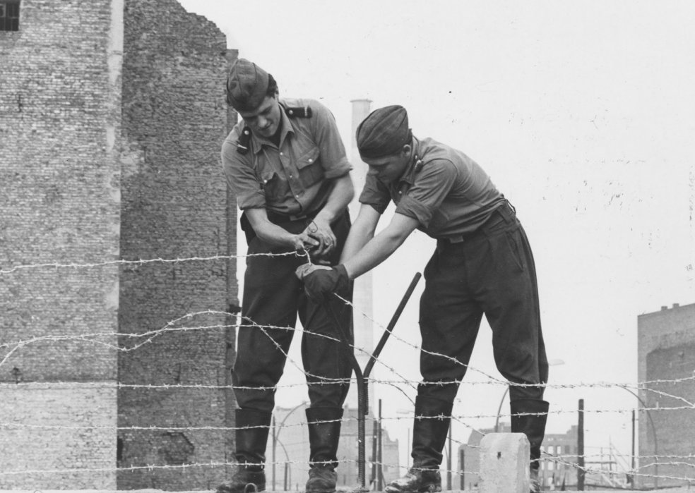 Barbed wire is installed on top of the Wall (Kreuzberg district, Prinzenstrasse), October 1961