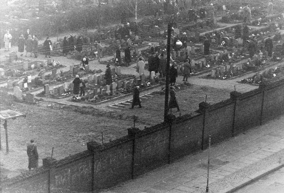 East Berliners visiting St. Hedwig's Cemetery on Liesenstrasse are checked and observed by border police, 26 November 1961